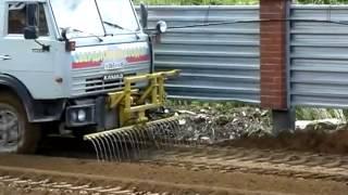 Смотреть видео Работы по устройству слоев износа дорожных покрытий