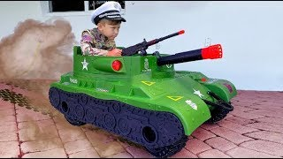 Senya pretend play a military man on a TANK.