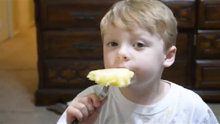 Kid eating Pineapple for the First Time