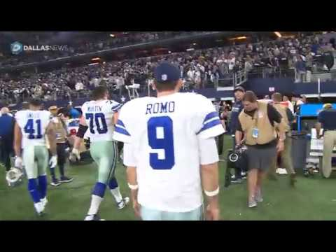 Cowboys QB Tony Romo walks off the field after loss to Green Bay
