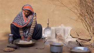 Shot of an Indian housewife kneading the wheat dough for chapatis / Roti's