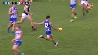North Melbourne's Jy Simpkin kicks a great goal after a kick from P...