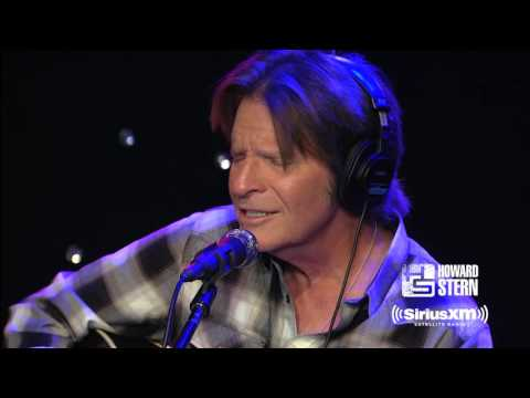 "John Fogerty Performs ""Have You Ever Seen The Rain?"" For Howard Stern"