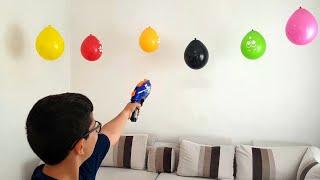 Buğra NERF Tabancası ile Balonları Patlattı. Eğlenceli Çocuk Videosu