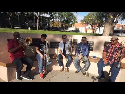 An Inspiring group of Young Trombone Players Jam on a Sunny Day