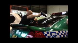 Window Tinting a police car - Exclusive Tint Sydney - Heat Shrinking