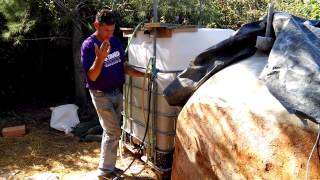 Testing Grace Village floating IBC digester with M