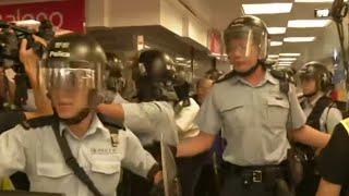 Pro-democracy demonstrators clash with government supporters in Hong Kong
