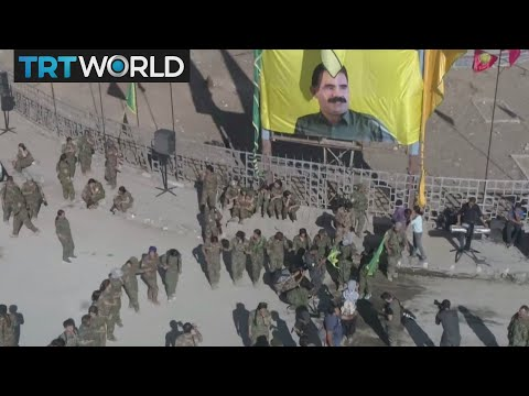 The War in Syria: SDF raises banner in Raqqa showing PKK leader