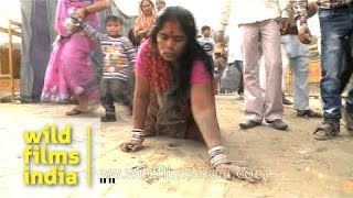 Female devotee crawling towards ghat during Chatt Puja