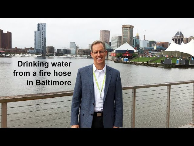 Drinking water from a fire hose in Baltimore