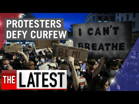 Protesters defy curfew in Washington despite increased military presence | 7NEWS