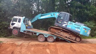 Excavator Loading onto a Truck without Ramp in Thailand