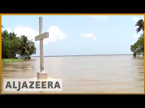 🇮🇳 Kerala floods 2018: Some evacuees return home despite risks as floods recede