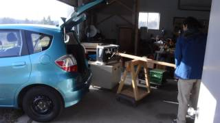 unloading heavy planer from car trunk without lifting