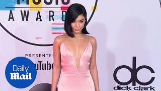 Vanessa Hudgens is pretty in pink arriving at the 2018 AMAs