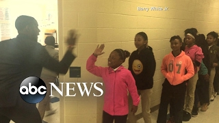 Fifth-grade teacher Barry White Jr. of Ashley Park Elementary School in Charlotte, North Carolina, greets his students with special handshakes every day before ...