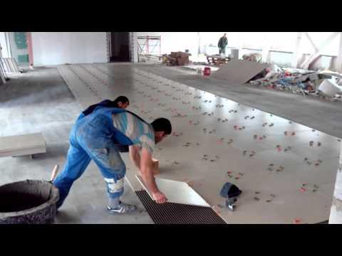 Промышленная укладка плитки 40 квадратов в час.