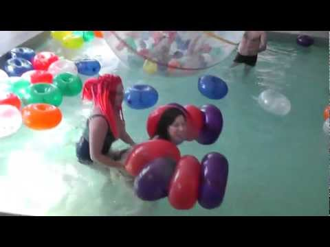 Domina Elle hosts Montreal Fetish Weekend balloons in the pool party