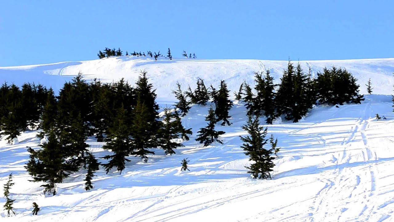 hill climb with a snowboard