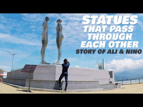 Download Statue of Love Rotates Through Each Other & Kiss