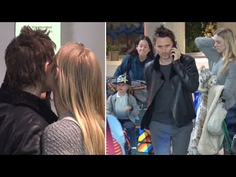 Matt Bellamy Shows PDA With Girlfriend At LAX Returning Home With Son Bingham
