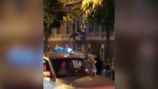 Russian fans clash with police during celebration of WC win over Spain