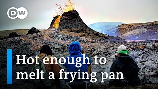 Tourists flock to Iceland volcano, cook food on lava | DW News