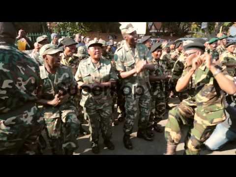 Long shot of veteran soldiers dancing and singing. Member...