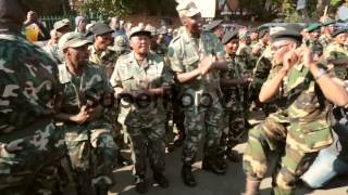 Long shot of veteran soldiers dancing and singing. Member...