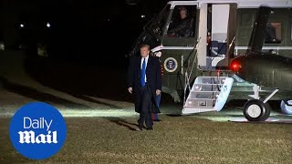 Donald Trump arrives back at the White House from Vietnam
