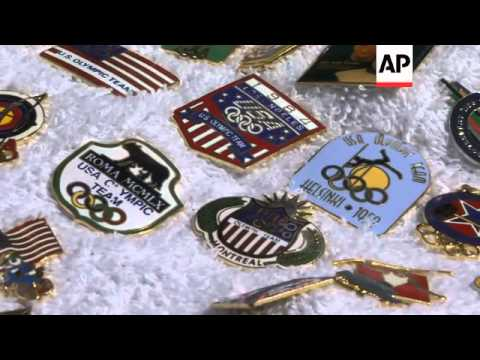 Olympics a mecca for pin collectors who gather to trade shiny mementoes