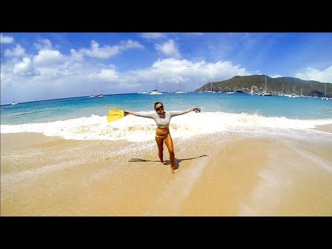 Funday in paradise. Fighting waves in Bequia, St Vincent and the grenadines, Caribbean