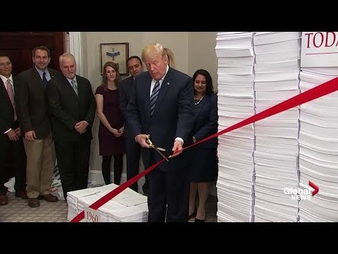 In bizarre ribbon cutting ceremony, Trump promises to reduce regulations