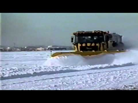 Chris Michaels - O'Hare plow dumping snow on passing cars