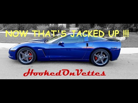 Jacking up C6 Corvette with floor jack and jack stands.