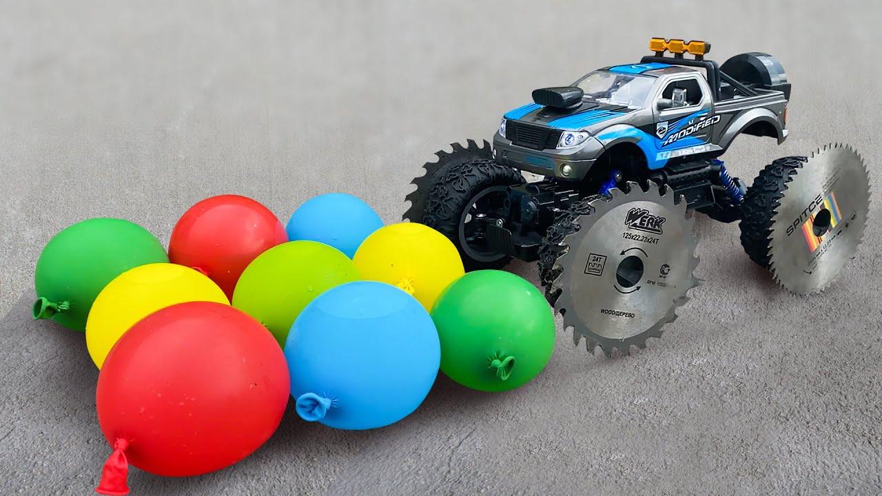 Experiment: Traxxas Xmaxx SAW BLADE WHEELS VS Balloons