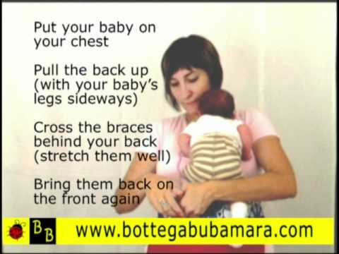how to hold a newborn baby while breastfeeding