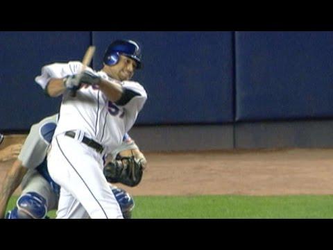 Santana breaks his bat but gets the hit