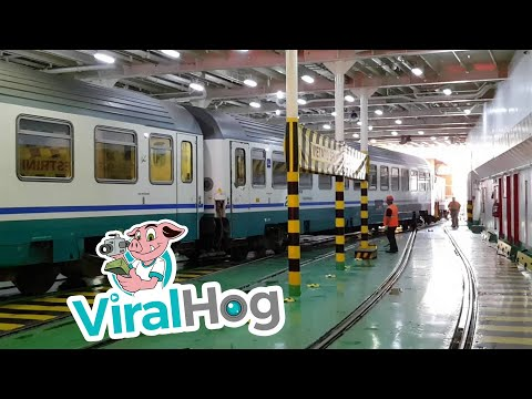 Train Boarding a Boat