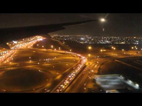 B777 Emirates landing in Dubai at night