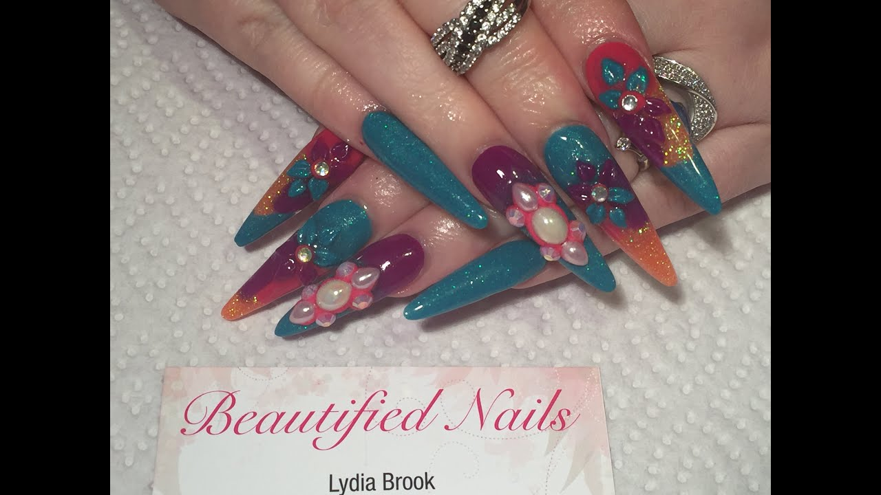 Acrylic nails, long stiletto sculpted nails using crystal nails ...