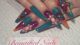 Acrylic nails, long stiletto sculpted nails using crystal nails products