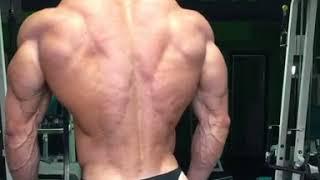 Jonay Mesa Navarro flexing in the gym