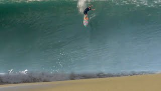 Surfers Attempt To Ride The Biggest Swell To Ever Hit This Beach (Raw Footage)