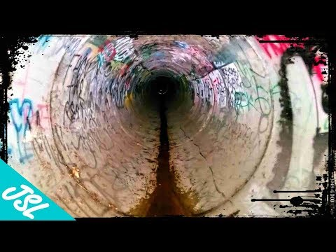 "They Call It ""Stoner Slide.""  Bald Guy Finds Secret Underground Water Slide Down a Sewer Pipe."
