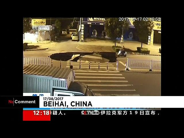 Moped rider falls down sinkhole in china