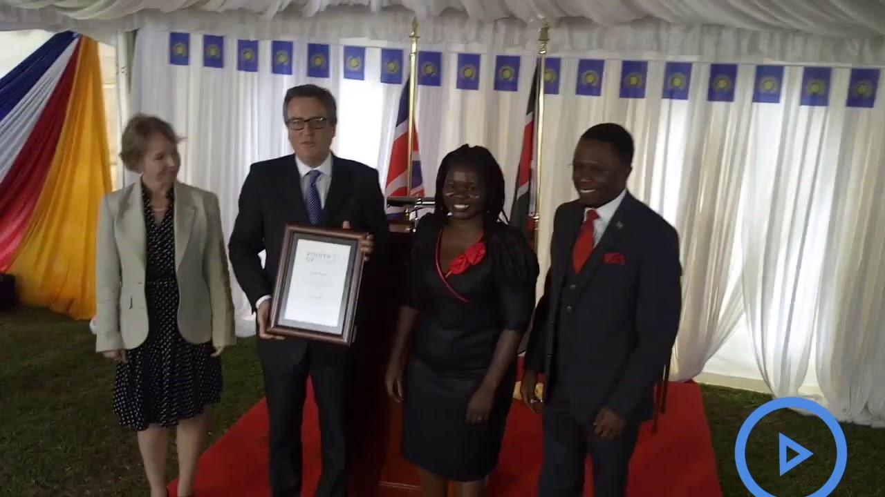 Kenyan receives an award from Queen Elizabeth