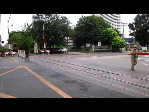 Makkasan Railway and Phetchutai road level crossing on the Eastern line, Bangkok, Thailand