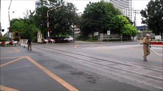 Makkasan Railway and Phetchutai road level crossing on the Eastern line, Bangkok, Thailand